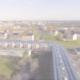 Drohnenüberflug über Genossenschaftsgebäude mit PV