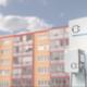 Ladestation mit Mietwohnungen im Hintergrund