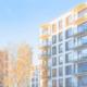 Neubau Mietwohnungen mit Sonnenstrahlen
